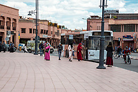 Marrakesh, Morocco.  Boarding a Bus in City Traffic.