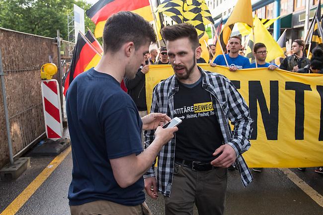 Knapp 100 Mitglieder und Anhaenger der sog. &quot;Identitaeren&quot; demonstrierten am Freitag den 17. Juni 2016 in Berlin. Angemeldet waren laut Veranstalter 400 Teilnehmer. Die rechtsextremen Teilnehmer des Aufmarsches kamen aus Berlin, Bayern und Oestrreich und skandierten Parolen wie &quot;Berlin ist unsere Stadt&quot;, &quot;Festung Europa, macht die Grenzen dicht&quot; und No Border, No Nation, Stop Immigration&quot;.<br /> Links im Bild: Martin Sellner, Gruendungsmitglied der &quot;Identitaeren Bewegung Oesterreich&quot; (IBOe).<br /> Rechts im Bild: Karsten Vielhaber (alias Karsten<br /> Verber), Identitaere Berlin.<br /> 17.6.2016, Berlin<br /> Copyright: Christian-Ditsch.de<br /> [Inhaltsveraendernde Manipulation des Fotos nur nach ausdruecklicher Genehmigung des Fotografen. Vereinbarungen ueber Abtretung von Persoenlichkeitsrechten/Model Release der abgebildeten Person/Personen liegen nicht vor. NO MODEL RELEASE! Nur fuer Redaktionelle Zwecke. Don't publish without copyright Christian-Ditsch.de, Veroeffentlichung nur mit Fotografennennung, sowie gegen Honorar, MwSt. und Beleg. Konto: I N G - D i B a, IBAN DE58500105175400192269, BIC INGDDEFFXXX, Kontakt: post@christian-ditsch.de<br /> Bei der Bearbeitung der Dateiinformationen darf die Urheberkennzeichnung in den EXIF- und  IPTC-Daten nicht entfernt werden, diese sind in digitalen Medien nach &sect;95c UrhG rechtlich geschuetzt. Der Urhebervermerk wird gemaess &sect;13 UrhG verlangt.]