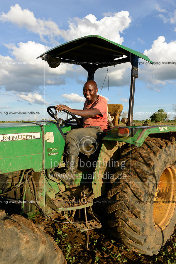 ZAMBIA, Mazabuka, medium scale farmer practise conservation farming, ripping furrows with John deere Tractor to sow cotton seeds, ripping protects the soil instead of ploughing