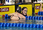 19 MAR 2016: Virginia's Leah Smith, right, is congratulated by Lindsey Clary of Ohio State after winning the 1650 Yard Freestyle final during the Division I Women's Swimming & Diving Championship held at the Georgia Tech Aquatic Center in Atlanta, GA. David Welker/NCAA Photos