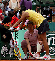 Kimiko Date Krumm (JPN) receives medical treatment in her match against Dinara Safina (RUS) (9) in the first round of the women's singles. Kimiko Date Krumm beat Dinara Safina 3-6 6-4 7-5..Tennis - French Open - Day 3 - Tue 25 May 2010 - Roland Garros - Paris - France..© FREY - AMN Images, 1st Floor, Barry House, 20-22 Worple Road, London. SW19 4DH - Tel: +44 (0) 208 947 0117 - contact@advantagemedianet.com - www.photoshelter.com/c/amnimages
