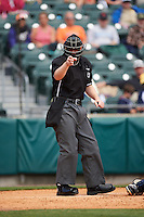 Umpire Max Guyll makes a call during a game between the Toledo Mudhens and Buffalo Bisons on May 18, 2016 at Coca-Cola Field in Buffalo, New York.  Buffalo defeated Toledo 7-5.  (Mike Janes/Four Seam Images)