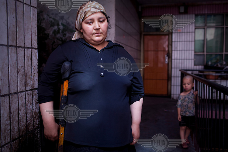 30 year old Tursun Gul, who stood up to tanks and hobbled alone in front of a crowd of protestors to demand the return of her husband who was arrested following the ethnic riots in Urumqi. Ethnic violence between the Uighur and Han Chinese erupted in the city a few days earlier..