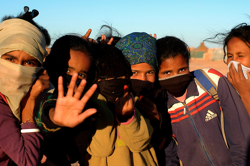 Children are pictured in the wilaya of Ausserd on December 14, 2003.Saharawi people have been living at the refugee camps of the Algerian desert named Hamada, or desert of the deserts, for more than 30 years now. Saharawi people have suffered the consecuences of European colonialism and the war against occupation by Moroccan forces. Polisario and Moroccan Army are in conflict since 1975 when Hassan II, Moroccan King in 1975, sent more than 250.000 civilians and soldiers to colonize the Western Sahara when Spain left the country. Since 1991 they are in a peace process without any outcome so far. (Ander Gillenea / Bostok Photo)