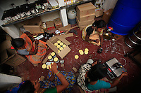Irula women are fulling honey jars the Hasanur resource center. Last year, Keystone foundation marketed 16 tons of honey. Keystone established resource centers near tribal villages to promote non-timber forest products. Here in Hasanur, seven Irula women from Thaladasalatti are preparing jam, honey, nuts and millet.