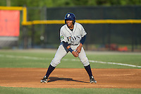 Eleardo Cabrera (25) of the Princeton Rays takes his lead off of first base against the Burlington Royals at Burlington Athletic Stadium on June 24, 2016 in Burlington, North Carolina.  The Rays defeated the Royals 16-2.  (Brian Westerholt/Four Seam Images)