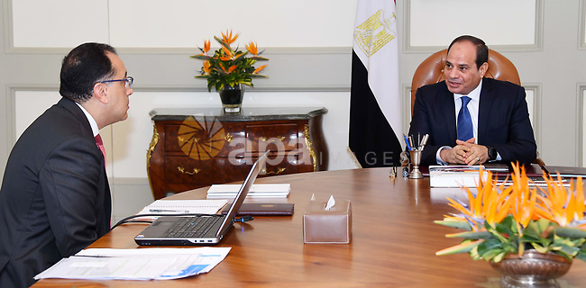Egyptian President Abdel Fattah al-Sisi meets with Mustafa Madbouli, Prime Minister in Cairo, Egypt on July 4, 2018. Photo by Egyptian President Office