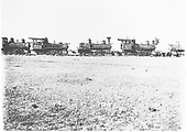 Several engines on the Alamosa scrap line.  Only #31 is easily identifiable.  No tenders are present and various pieces and parts have been removed for use on other engines.<br /> D&amp;RG  Alamosa, CO  5/26/1908
