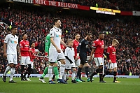 Federico Fernandez of Swansea City leads the team on to the pitch prior to the Premier League match between Manchester United and Swansea City at the Old Trafford, Manchester, England, UK. Saturday 31 March 2018