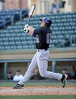 Right fielder Cody Jones (12) of the Western Carolina Catamounts in a game against the Cincinnati Bearcats on Sunday, February 24, 2013, at Fluor Field in Greenville, South Carolina. Cincinnati won in 10 innings, 7-6. (Tom Priddy/Four Seam Images)