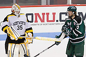 Alex Peck (WIT - 35) passes a Panther helmet to Zach Fox (PSU - 23). - The visiting Plymouth State University Panthers defeated the Wentworth Institute of Technology Leopards 2-1 on Monday, November 19, 2012, at Matthews Arena in Boston, Massachusetts.
