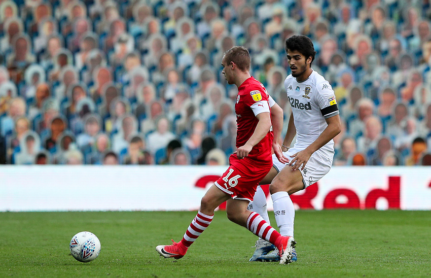 Leeds United's Pascal Struijk battles with Barnsley's Luke Thomas<br /> <br /> Photographer Alex Dodd/CameraSport<br /> <br /> The EFL Sky Bet Championship - Leeds United v Barnsley - Thursday 16th July 2020 - Elland Road - Leeds<br /> <br /> World Copyright © 2020 CameraSport. All rights reserved. 43 Linden Ave. Countesthorpe. Leicester. England. LE8 5PG - Tel: +44 (0) 116 277 4147 - admin@camerasport.com - www.camerasport.com