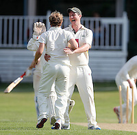 Jack Atchinson (R) of North London congratulates Jordan Gregory (L) after he took a Brentham wicket during the Middlesex County Cricket League Division Three game between North London and Brentham at Park Road, London, on Sat July 23, 2016