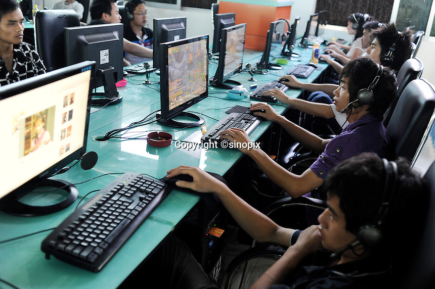 A packed internet cafe in Guangzhou, China. Internet cafe in China that admit three or more underage patrons will have their licences revoked under the government's latest effort to tighten controls on web access in the world's largest online market..21 Apr 2010