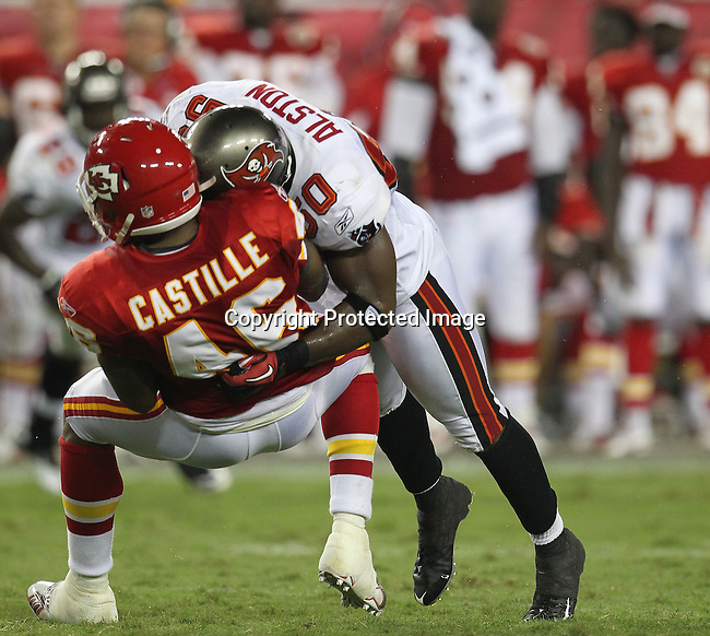 Tampa Bay Buccaneer's linebacker Jon Alston knocks Kansas City Chief's running back Tim Castille off his feet.  The Buccaneers defeated the Chiefs 20-15 during an NFL preseason game Saturday, Aug. 21, 2010 in Tampa,Fla. (AP Photo/Margaret Bowles).