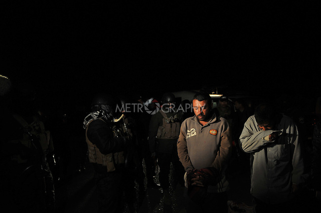 KIRKUK, IRAQ: Two Iraqi men are arrested under suspicion of being terrorists during an anti-terror raid...After receiving intelligence about a terrorist training camp in the Hamria mountains, the Kirkuk Regional Police conduct a dawn raid...This is the first anti-terror raid in Kirkuk after the withdrawal of US troops..Photo by Pazhar Mohammad/Metrography