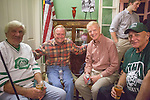 From left to right, Joe Zieleniewski, Ken Arvidson, Jerry Nuerge, and John Sebok pose for a photo during the 1960s hockey alumni event at the Konneker Alumni House on September 30, 2016.