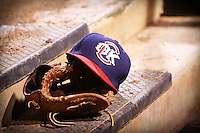 Redhawks hat and glove after the MiLB matchup between the New Orleans Zephyrs and the Oklahoma City Redhawks at Chickasaw Bricktown Ballpark on June 10th, 2012 in Oklahoma City, Oklahoma. The Redhawks defeated the Zephyrs 12-9  (William Purnell/Four Seam Images)