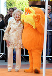 Betty White with the Lorax at the Dr. Seuss The Lorax Premiere held at  Universal Studios  Hollywood, Universal City, CA.. February 19, 2012