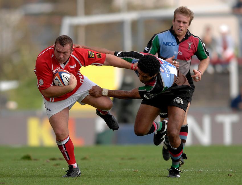 Photo: Richard Lane..Llanelli Scarlets v NEC Harlequins. EDF Anglo-Welsh Cup. 01/10/2006. .Scarlets' Craig Dunlea is tackled by Chris Hala'ufia.