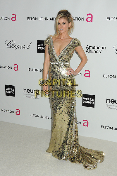 Marisa Miller.20th Annual Elton John Academy Awards Viewing Party held at West Hollywood Park, West Hollywood, California, USA..February 26th, 2012.oscars full length dress hand on hip gold sequins sequined low cut neckline cleavage  .CAP/ADM/BP.©Byron Purvis/AdMedia/Capital Pictures.