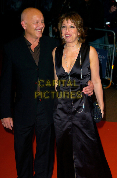 "SUSANNE BIER (DIRECTOR) & GUEST.The Times BFI 51st London Film Festival UK premiere of ""Things We Lost In The Fire"" at the Odeon West End cinema, Leicester Square, London, England..October 24th, 2007.full half 3/4 length black dress suit silver necklace low cut neckline .CAP/CAN.©Can Nguyen/Capital Pictures"