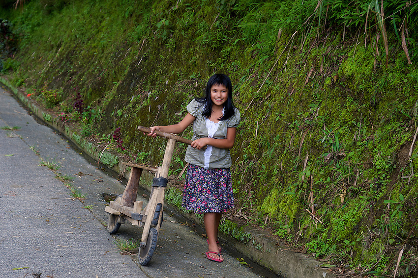 Girl and her wooden Bike Banaue Mountain Province Rice Terraces Philippines