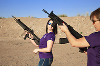 "USA. Arizona state. Peoria. Peoria is distant 50 km from Phoenix. Cowtown Shooting Range. Cowtown is a semi-private outdoor shooting range and firearms training facility. Carrie Lightfoot (R) holds a AK 47 in her hands while her colleague Nicole Goldberger (L) a Beretta C4 Storm. Both women train their shooting skills with two semi-automatic rifles. Carrie Lightfoot is the founder and CEO of ""The Well Armed Woman. Where the Feminine and Firearms Meet"" which sell online resources for women gun owners. The AK-47 (also known as the Kalashnikov, AK, or Kalash) is a selective-fire automatic or semi-automatic gas-operated 7.62×39mm assault rifle, developed in the Soviet Union by Mikhail Kalashnikov. The Beretta Cx4 Storm is a pistol-caliber carbine aimed at the sporting, personal defense and law enforcement markets. A firearm is a portable gun, being a barreled weapon that launches one or more projectiles often driven by the action of an explosive force. Most modern firearms have rifled barrels to impart spin to the projectile for improved flight stability. The word firearms usually is used in a sense restricted to small arms (weapons that can be carried by a single person). The right to keep and bear arms is a fundamental right protected in the United States by the Second Amendment of the Bill of Rights in the Constitution of the United States of America and in the state constitutions of Arizona and 43 other states. 28.01.16 © 2016 Didier Ruef"