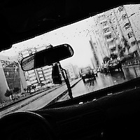 A city street with traffic seen through the taxi window during a heavy rain in Quito, Ecuador, 30 October 2013.