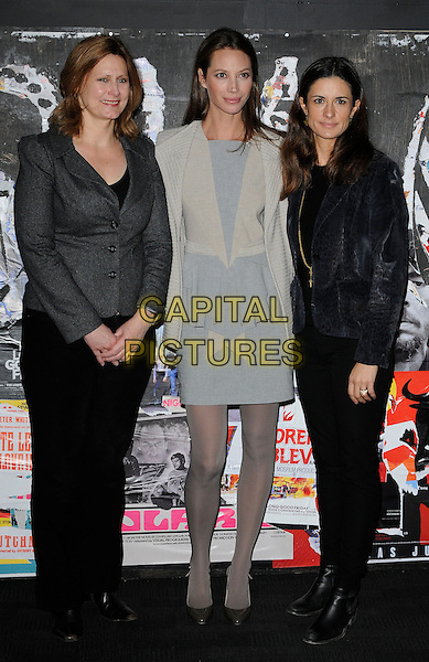 "SARAH BROWN, CHRISTY TURLINGTON BURNS  & LIVIA GIUGGIOLI .At the ""No Woman No Cry"" premiere during the 54th BFI London Film Festival, BFI Southbank, London, England, UK, October 23rd 2010..full length  jacket cream blue grey gray peplum dress tights ruffle tights shoes wool blazer black trousers pinstripe beige .CAP/CAN.©Can Nguyen/Capital Pictures."