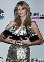 LOS ANGELES, CA - NOVEMBER 24: Taylor Swift in the press room at the 2013 American Music Awards held at Nokia Theatre L.A. Live on November 24, 2013 in Los Angeles, California. (Photo by Celebrity Monitor)