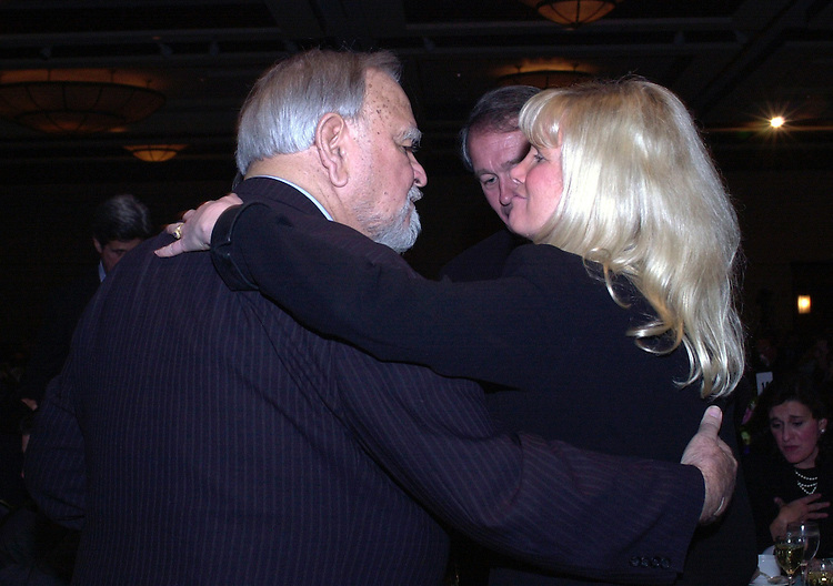 6moakley040401 -- Congressman Joseph Moakley, D-MA, gets a hug from Dr. Susan Blumenthal during a dinner held in honor of Moakley's decision to retire.