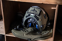 Pilot helmet ready for use by its owner. British Merlin helicopter practice in the Arctic, over the terrain near Bardufoss, Norway. <br /> In 2019 the Arctic exercise Clockwork passed 50 years of training in Norway, and now has a permanent base within the Norwegian Air Force base at Bardufoss. <br /> <br /> 845 Naval Air Squadron is a squadron of the Royal Navy's Fleet Air Arm. Part of the Commando Helicopter Force, it is a specialist amphibious unit operating the Commando Merlin Mk3 helicopter and provides troop transport and load lifting support to 3 Commando Brigade Royal Marines.<br /> <br /> &copy;Fredrik Naumann/Felix Features