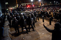 Police charge protestors during a student demonstration in Westminster, central London on the day the government passed a bill to increase university tuition fees.