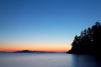 Sunset over Rosario Strait from Jones Island Marine State Park, San Juan Islands, Washington State, USA