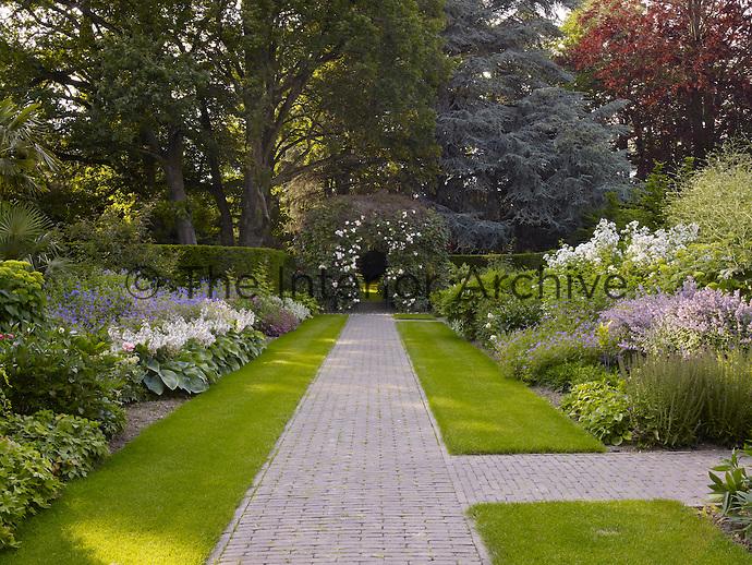 Brick pathways dissect the garden between the flowerbeds