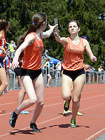 Pennsbury's Erin O'Connell (R) hands off to teammate Hannah Molloy in the 4x800 relay at the Central Bucks West Relays Saturday April 18, 2015 in Doylestown, Pennsylvania.  (Photo by William Thomas Cain/Cain Images)