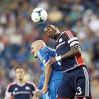 Philadelphia Union forward Conor Casey (6) and New England Revolution defender Jose Goncalves (23) battle for head ball.  In a Major League Soccer (MLS) match, the New England Revolution (dark blue) defeated Philadelphia Union (light blue), 5-1, at Gillette Stadium on August 25, 2013.