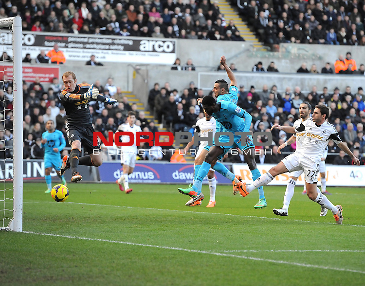Tottenham Hotspur's Emmanuel Adebayor heads past Swansea City's Gerhard Tremmel to open the scoring -   19/01/2014 - SPORT - FOOTBALL - Liberty Stadium - Swansea - Swansea City v Tottenham Hotspur - Barclays Premier League<br /> Foto nph / Meredith<br /> <br /> ***** OUT OF UK *****