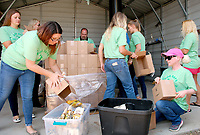 Janelle Jessen/Herald-Leader<br /> Simmons Pet Foods employees and NWA Tailwaggers volunteers unload dog treats at the Siloam Springs Animal Shelter on Tuesday morning. The company kicked off its Dog Days of Summer Treat Giveaway at the Siloam Springs Animal Shelter. Overall, 15,000 packages of treats were distributed to 12 shelters across Northwest Arkansas.
