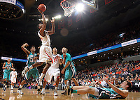 Virginia beat UNC Wilmington 69-67 Monday Jan. 18, 2010 in Charlottesville, Va. Virginia forward/center Jerome Meyinsse (55) (Photo/The Daily Progress/Andrew Shurtleff)