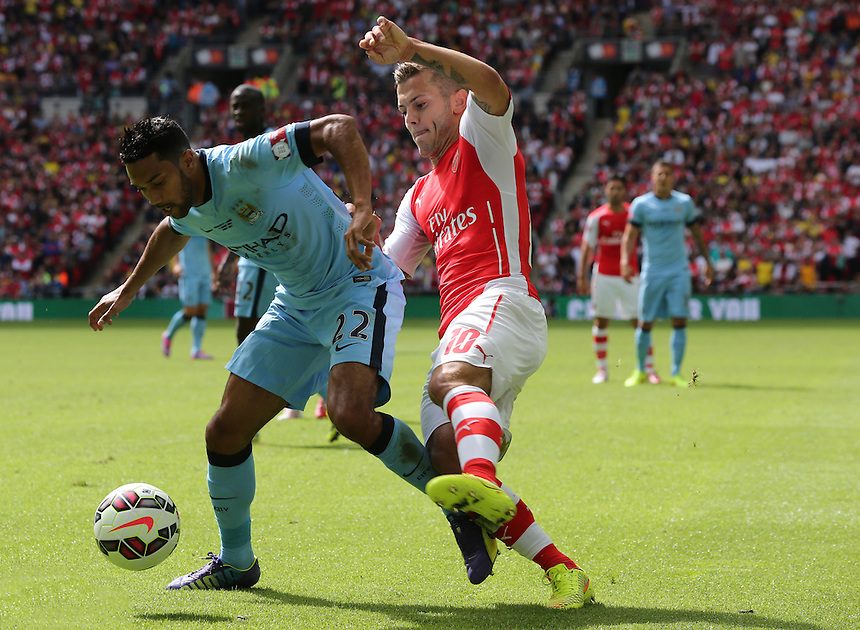 Manchester City's Ga&euml;l Clichy holds of Arsenal's Jack Wilshere<br /> Photographer Kieran Galvin/CameraSport<br /> <br /> Football Friendly - FA Community Shield - Arsenal v Manchester City - Sunday 10th August 2014 - Wembley - London<br /> <br /> &copy; CameraSport - 43 Linden Ave. Countesthorpe. Leicester. England. LE8 5PG - Tel: +44 (0) 116 277 4147 - admin@camerasport.com - www.camerasport.com