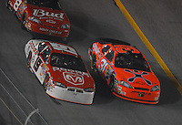 Feb 10, 2007; Daytona, FL, USA; Nascar Nextel Cup driver Elliott Sadler (19) races alongside Jeff Burton (31) during the Budweiser Shootout at Daytona International Speedway. Mandatory Credit: Mark J. Rebilas