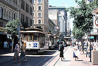 San Francisco:  the cable car turnaround, Powell at Market. (Looking up Powell to the St. Francis.)  Photo '89.