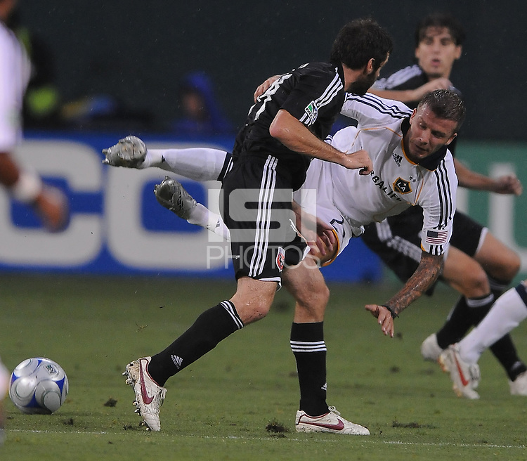Los Angeles Galaxy midfielder David Beckham (23) gets foued by DC United midfielder Bel Olsen (14)  DC United tied with Los Angeles Galaxy 0-0 at RFK Stadium, Saturday August 22, 2009.