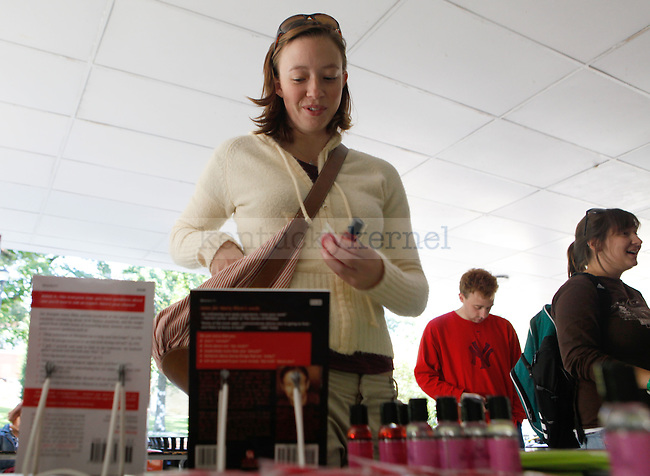 Psychology senior Kate LeBoone takes some condoms and lubricants from one of the SEX WEEK booths on the Student Center patio Monday, October 5, 2009. Photo by Zach Brake | Staff