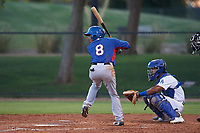 AZL Rangers Derwin Barreto (8) at bat in front of catcher Juan Zabala (60) during an Arizona League game against the AZL Dodgers Mota at Camelback Ranch on June 18, 2019 in Glendale, Arizona. AZL Dodgers Mota defeated AZL Rangers 13-4. (Zachary Lucy/Four Seam Images)