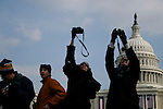 Spectators take photos of former president Bush leaving the White House aboard a Marine helicopter after the inauguration of Barack Obama as 44th President of the United States of America, Tuesday, Jan. 20, 2009, in Washington, D.C. (Marisa McGrody/pressphotointl.com)