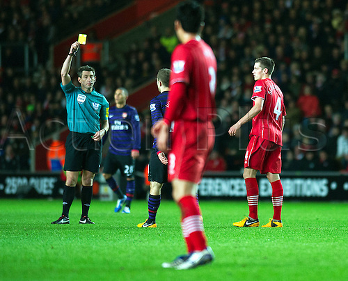 01.01.2013 Southampton, England.  Southampton's Morgan Schneiderlin receives a yellow card during the Premier League game between Southampton and Arsenal at St Mary's Stadium.