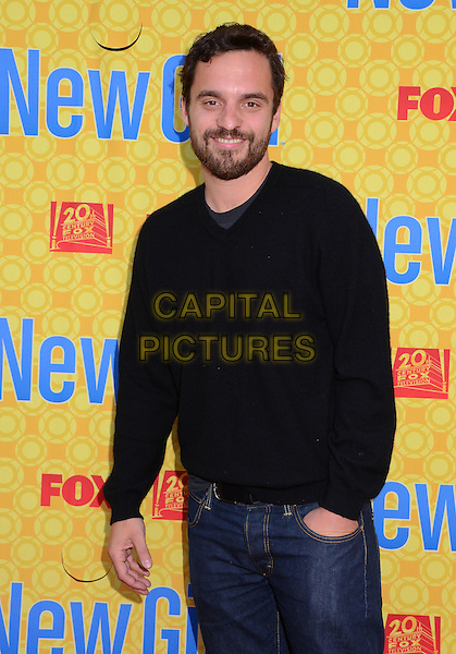 Jake Johnson.'New Girl' cast at screening and Q&A at Leonard H. Goldenson Theatre, North Hollywood, California, USA..7th May 2012.half length black hand in pocket beard facial hair sweater jumper top  .CAP/ADM/BT.©Birdie Thompson/AdMedia/Capital Pictures.